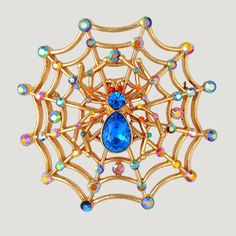 Crystal Spider Net Brooch from Butler & Wilson