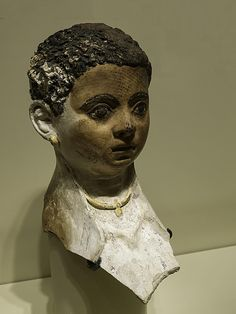 https://flic.kr/p/zUd6Lp | Mummy mask of a young boy Egypt Roman Period 3rd century CE Plaster and linen | The child wears a gold bulla, an amulet given to male children in Ancient Rome nine days after birth to ward off evil.  Photographed at the Seattle Art Museum in Seattle, Washington.