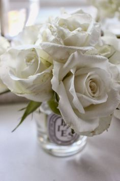 bits + pieces: roses, fresh blooms and an up-cycled mini diptyque jar.