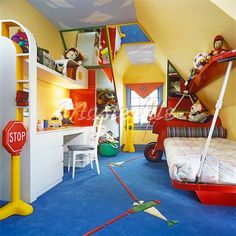 This is a Triadic children bedroom because red, yellow and blue are equidistant on the colour wheel.