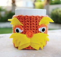 Lorax Inspired Coffee Mug Tea Cup Cozy: Dr. Seuss -ish Cartoon Animation Crochet Knit Sleeve from littlepopos on Etsy. Crochet Coffee Cozy, Crochet Cozy, Crochet Crafts, Yarn Crafts, Crochet Projects, Craft Projects, Craft Ideas, Cozy Cover, Mug Warmer