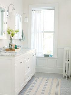 Pretty white and pastel bathroom.