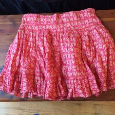 Apollo floral printed patterned skirt This is in great condition! Zipper on left side. Colors: salmon, pink and yellow. About 16 inches long. There are small belt loops on the waist. Apollo Skirts