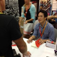 Charles Yu at the Pantheon booth at SDCC