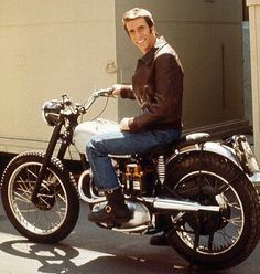 Henry Winkler aka The Fonz, star of the show 'Happy Days' on his 500cc Triumph motorbike.