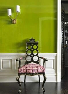 an antique pagoda chair with ikat fabric and a twig wall sconce make an eclectic and colorfully refined entry interior design by christina murphy