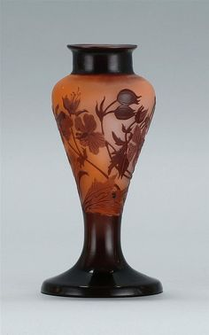 "GALLÉ CAMEO ART GLASS VASE Early 20th Century <br  /> With lily and foliate design in plum on a peach ground. Signed on side ""Gallé"". Height 6 1/4""."
