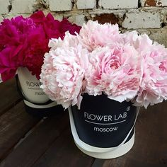 Flowers in a box. Pink Peonies.