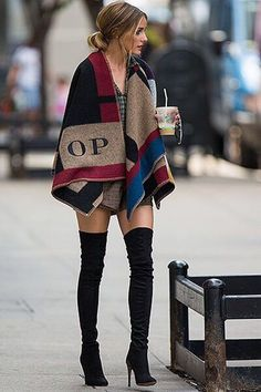 Burberry Poncho worn with high waist shorts and black thigh high boots. Olivia Palermo, Fall 2014.