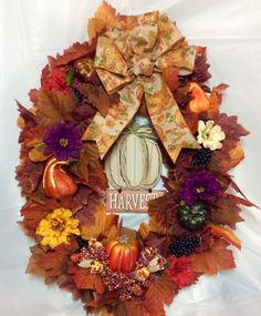 Fall wreath. Purple, gold, cream, orang zinnia, grapes, gourds