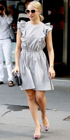 For a Paris stroll, Agron styled her ruffled seersucker sundress with Dolce & Gabbana shades and pink pumps.