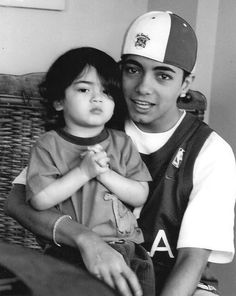 Omer Bhatti (age 20) with 2-year-old Blanket Jackson in 2004