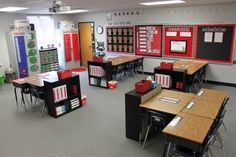 incredibly organized and cute classroom! nice touch to have shelves at the end of every desk grouping