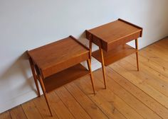 A pair of teak nightstands with beech legs by AB Carlstrom & Co Mobelfabrik…