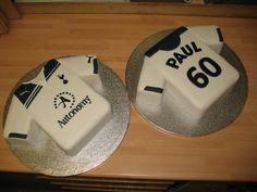 Tottenham Hotspur Football Shirt - 60th Birthday - Made from 2 x 10-inch square cakes, 2?-inch strip cut from one side then cut at an angle to make the sleeves (leaving enough for a small square cake each for my husband and I to have with a cup of tea once I was finished - for quality control purposes obviously. Covered in white fondant with navy fondant accents. The front logo was transferred by tracing onto clear plastic with a marker pen, flipping it over and painting the outline in…