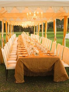 tents, chandeliers, parsons chairs and candles... could there be a more romantic dinner setting?