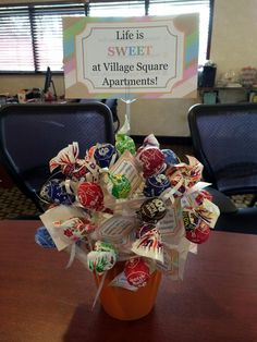 "Our new special/marketing campaign. Each lollipop has a different colored dot on the bottom. Whatever lollipop the prospect chooses, determines the special they will receive. All of the lollipops have a tag that says, ""Thanks for popping in Village Square Apartments!"""