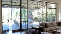 view 3 of 3 :: view from kitchen to exterior created by fabulous metal doors/picture window