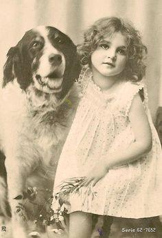 Vintage girl with dog postcard
