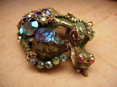 Gorgeous Vintage HAR Enamel Rhinestone Dragon brooch HUGE aurora borealis stones. $700.00, via Etsy.