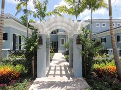 Lovely-West-Indies-decorating-ideas-for-Alluring-Exterior-Tropical-design-ideas-with-arbor-black-shutters-British-West-Indies-colorful-garden-gray-exterior-path-pavers.jpg (990×742)