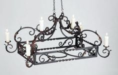 wrought iron pot racks - luces que remolinan
