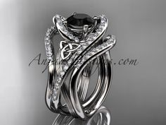 14kt white gold diamond celtic trinity knot wedding ring, engagement ring with a Black Diamond center stone and double matching band  CT7369S