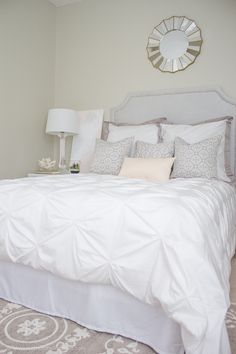 Gorgeous white and grey bedroom with a soft touch of pink. Duvet from Crane and Canopy @craneandcanopy