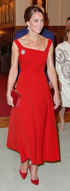 For the Canada trip's most formal event, a reception at Government House, the Duchess wore a vibrant red dress by British luxury label Preen, the Finella style. Kate carried a red calf-hair clutch by Jenny Packham we'd not seen previously, and wore Gianvito Rossi signature pumps in red. She wore the Queen's maple leaf brooch again, and her Soru Baroque Double-Sided Pearl Earrings.