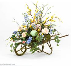 Spring arrangement in moss wheelbarrow - traditional - holiday decorations - chicago - FineStems