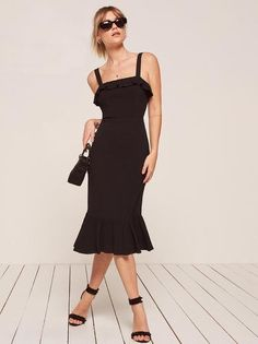 Where do you think you're going? This is a tight fitting, midi length dress with a ruffled neckline and hem.