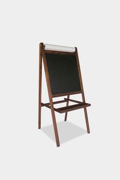 Wood with Solid Brass Hardware. Features chalkboard face with an art paper  roll, and collapsible design.  This item is made to order. Please allow 4-6 weeks for shipping.  Shipping will be charged separately and will vary by destination. Please  inquire for specific rates.
