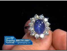 A beautiful blue star sapphire in a mount with a circle of white diamonds - what a marvelous ring.