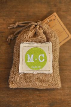 Rustic wedding idea: little burlap sacks for the favors, with hand sewn labels showcasing the couple's initials.