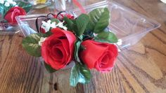 Red wrist corsage with black accents