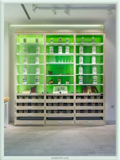 Traditional pharmacy pots in a modern structure. Boticana Pharmacy by Marketing-Jazz