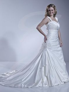 Jacquelin Bridals Canada - 29223 - Wedding Gown - Strapless sweetheart gown with pleated bust and side gather. Beaded band at empire waist. Bubble hem. Lace up back.