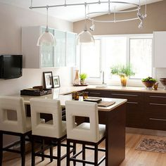 Increasing Efficiency In this home, a 1970s galley kitchen was transformed into a sleek and stylish alternative. By replacing windows at a higher level, additional counter space was able to be added, increasing the kitchen's efficiency when it comes to cooking.
