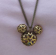 Disney Mickey Mouse Hidden Mickey Necklace Scrollwork Antique Gold Pendant Beads by AOSDESIGN on Etsy https://www.etsy.com/listing/189292697/disney-mickey-mouse-hidden-mickey