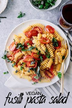 Perfect for outdoor vegan barbecues and picnics! 10 minutes Vegan Fusilli Pasta Salad with tomatoes, basil, garlic, and spicy chile flakes. #vegan #pastasalad #fusilli #tomato #Italian #basil #easy via @kristinatodini