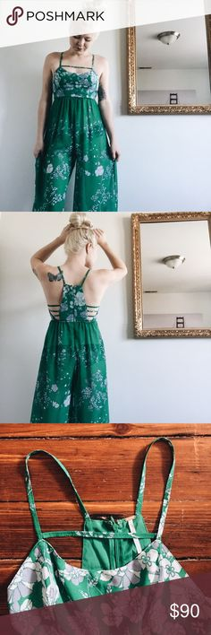 fяєє ρєσρℓє Jumpsuit Vintage inspired wideleg floral printed chiffon jumpsuit with strappy side detailing.  • Free People • Color: Black w/ floral accents • Size: 2 (S) • 100% Polyester • Machine wash cold • Hidden zipper • Import  Note* there is a small hole at the very bottom of the hidden zipper (but it's hidden so you can't see it since the zipper is inverted).   Please, no trades, reasonable offers considered, and will ship immediately! ✨ Free People Pants Jumpsuits & Rompers
