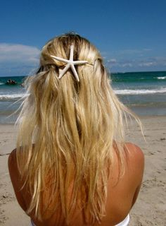 Hot glue a starfish to a hairclip or to a bobby pin.... great idea for the beach (:
