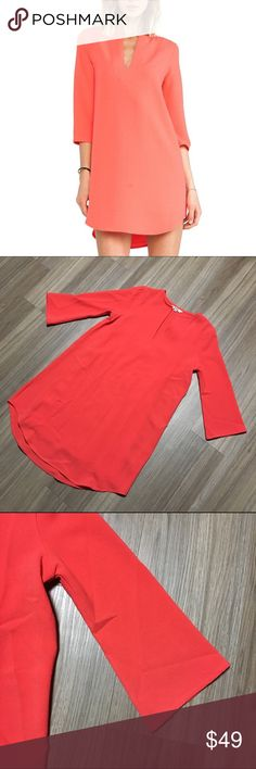 BB Dakota Coral Tunic Dress Gorgeous coral color tunic dress with v slit on front. Long sleeves with slight flare. Loose fit. 97% polyester, 3% spandex. The dress itself is in perfect condition but the slip (which is removable to begin with) one side attachment is broken. This does not affect the functionality of the dress what so ever, I just want to disclose. BB Dakota Dresses Long Sleeve