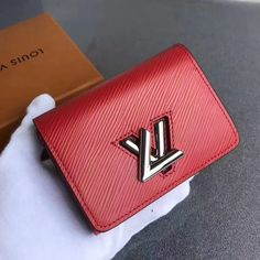 Louis Vuitton Twist Compact Wallet Epi Leather Red 2017 - Bags and Purses 👜 Louis Vuitton Red Purse, Louis Vuitton 2017, Louis Vuitton Wallet, Vuitton Bag, Louis Vuitton Handbags, Louis Vuitton Monogram, Handbags On Sale, Luxury Handbags, Designer Bags For Less