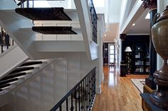 Black and White  - texture by using beadboard ceiling and wainscoting - stair tread runners that wrap around the treads | via Peter A. Sellar - Architectural Photographer