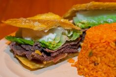 Steak Jibarito, Borinquen  This sandwich — featuring your choice of meat slathered in mayo and topped with tomato, lettuce, onion and melted American cheese stuffed between deep-fried garlicky plantains — is served at every Puerto Rican table in town, and it's as much a Chicago-staple as Italian Beef or deep dish pizza. Borinquen owner Juan Figueroa invented it a decade ago at his original California Ave. restaurant after reading about a plantain sandwich in a Spanish language newspaper…