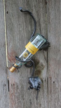 Metal Wine Rack Single Bottle holder  by toughandtwisted on Etsy, $165.00  Handforged Art