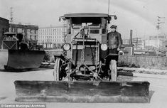 Old idea: Just as plows are attached to pickup trucks today, the same was done on early truck models like this Pierce Arrow from 1923 in Seattle