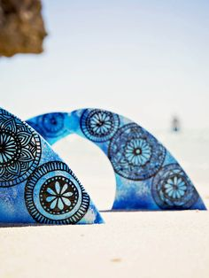 Surfboard fins – Blue Mandala – by Finatics ~ RRP $95. Make your board stand out from the rest with these unique surfboard fins hand painted by the talented Shannon Bawden.