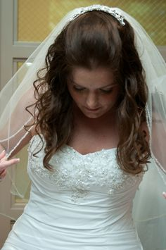 Wedding Hair! Half up, half down. lots of curls, with volume in the front.